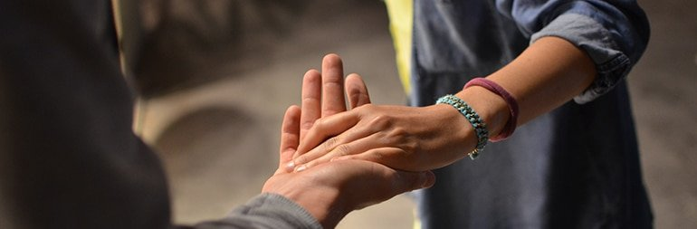 residential movers nyc- holding hands