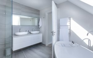 all white bathroom with the doors opened
