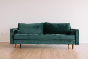 donate your stuff before moving- a green couch