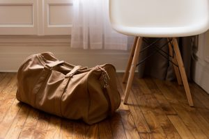 A bag on the floor as a part of the ultimate unpacking checklist