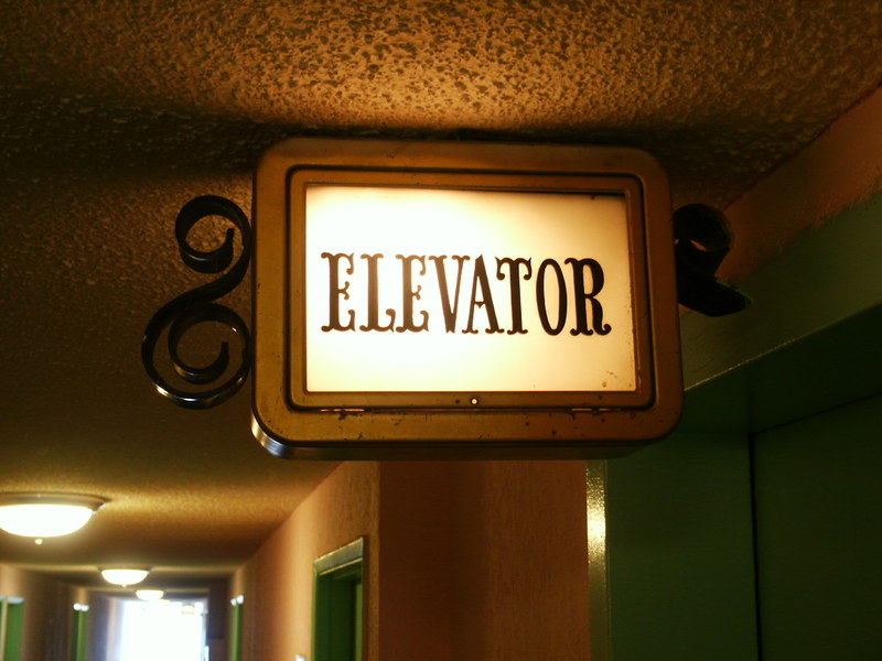 while waiting for movers reserve an elevator. Elevator sign inside a building