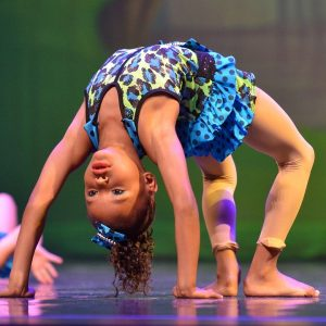 a girl performing acrobatic moves