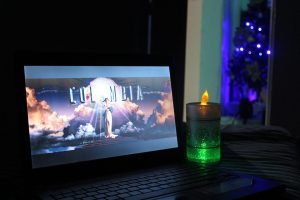 a laptop and a candle