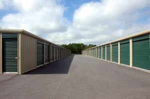 storage facility with storage units having green slide doors