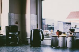 a kitchen counter with a black coffee maker
