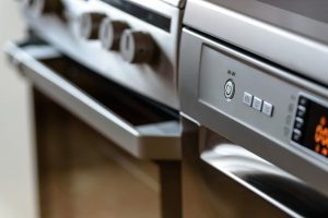 moving kitchen appliances - a dishwasher and a stove
