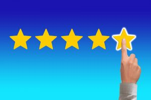 a finger confirming a five star review