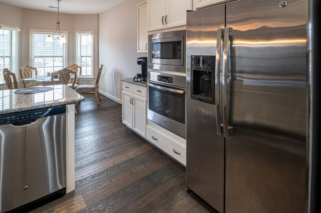 Astoria movers - the refrigerator, and the stove in a kitchen