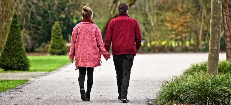 Couple walking to de-stress after a move