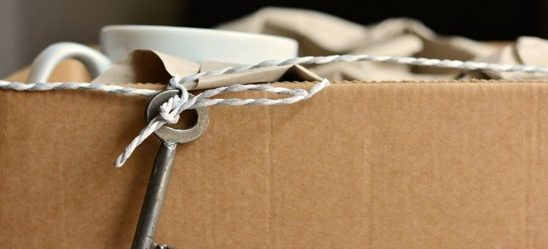 a packed box with a key hanging from the side