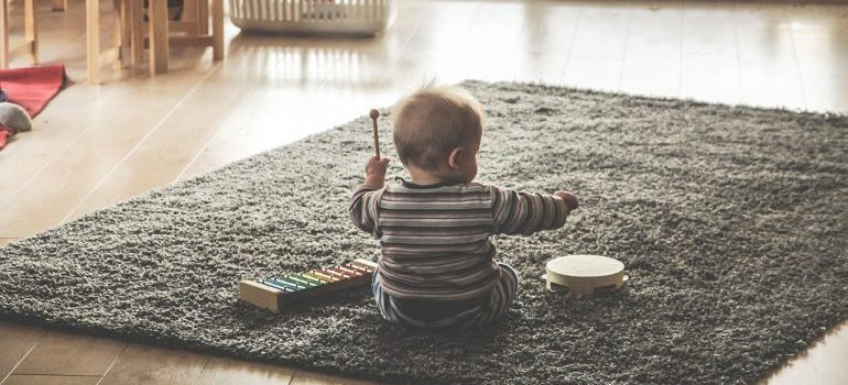 a baby playing with some musical instruments