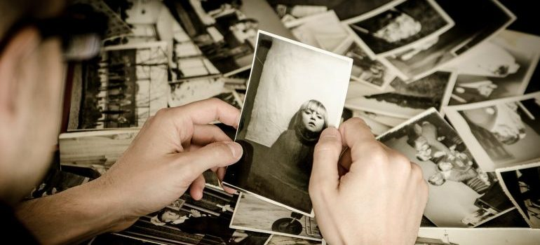 Man holding old photos - Packing assistance NYC