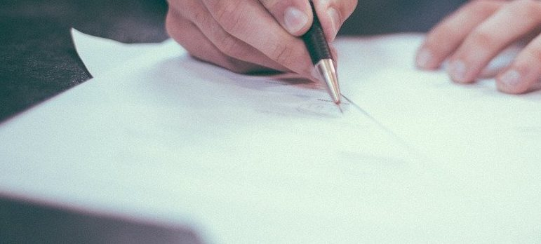 a person signing contract