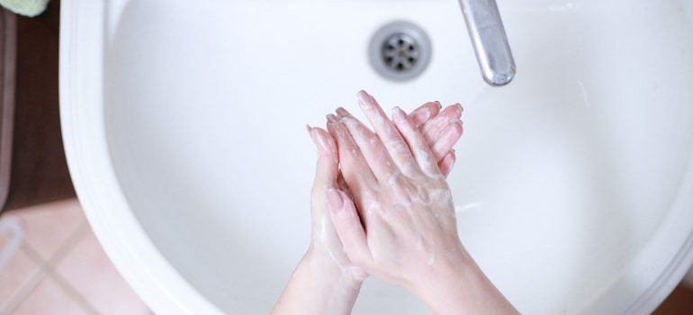 sanitize your office before and after moving - washing hands