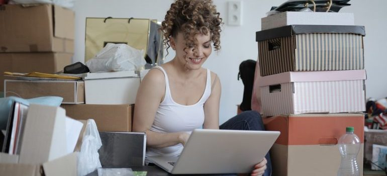 Woman preparing to pack and move a messy house