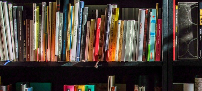 books on a shelf as a part of packing and moving your home library guide