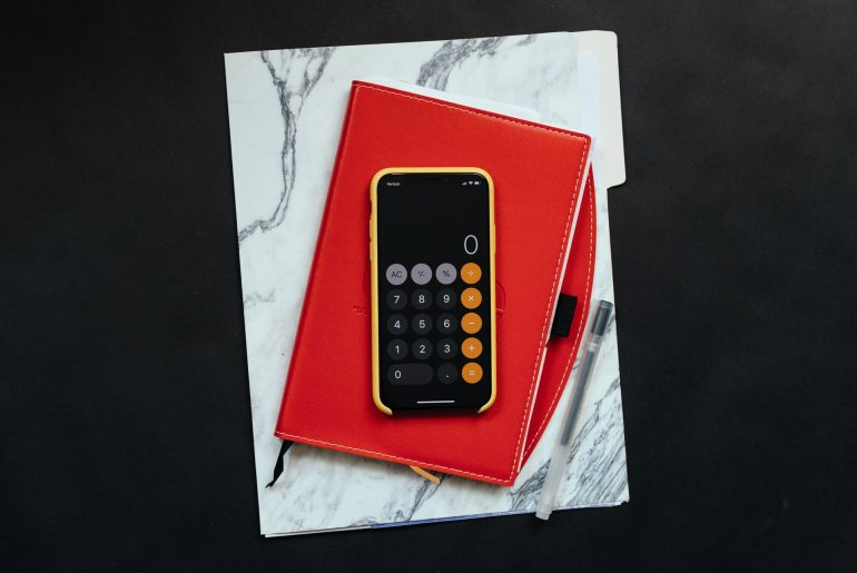 Mobile phone with calculator on a notebook