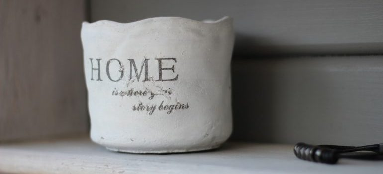 A jar with a sign home