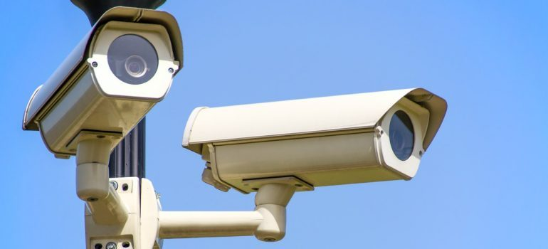 Cameras mounted on a post.