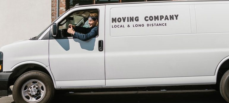 A guy driving a moving van