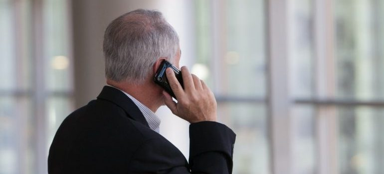A man calling someone on the phone