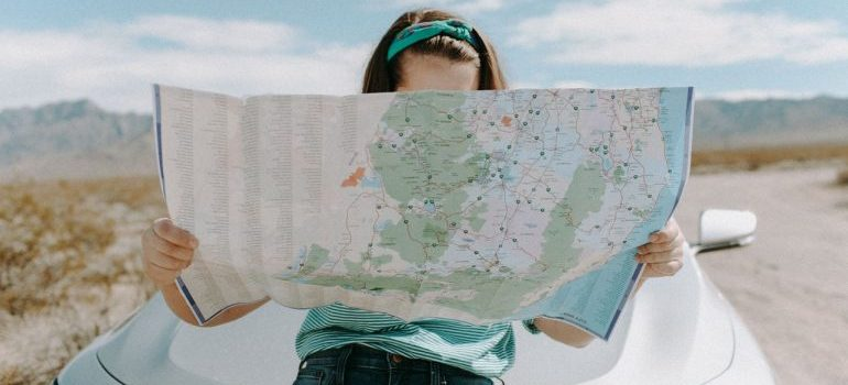 A woman looking at a map.