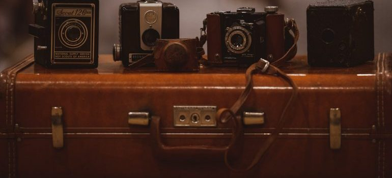 Old suitcase with cameras.