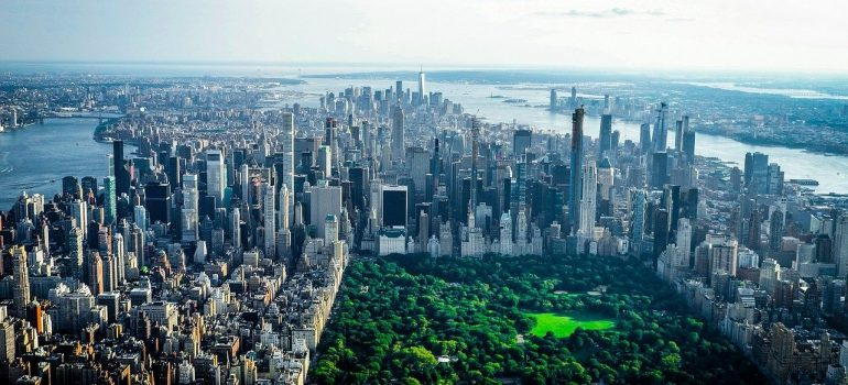 New York City, Central Park surrounded with buildings, that you will see when moving to NYC for a relationship.