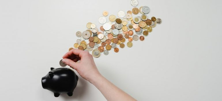 Putting coins in a piggy bank