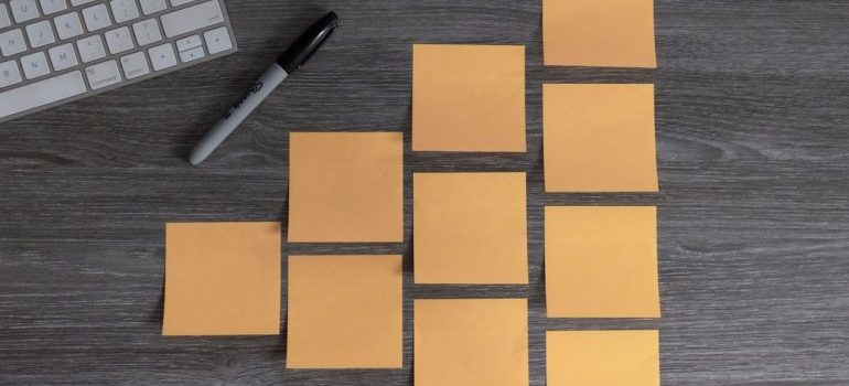 A person organizing sticky notes
