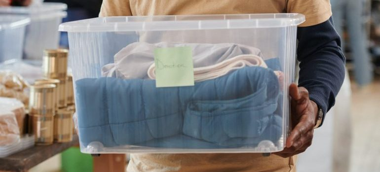 Plastic box with clothes